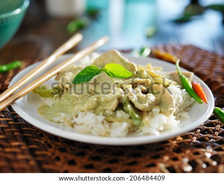 thai green curry with chicken on jasmine rice - stock photo