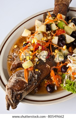 Thai  healthy food, Deep friend fish with sour and spicy fruit salad.