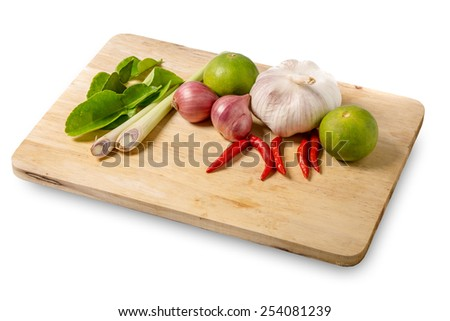 thai herb ingredients food  on wood on white background. - stock photo