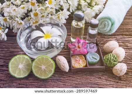 Thai herbal for spa therapy with Kaffir Lime on wooden background - stock photo