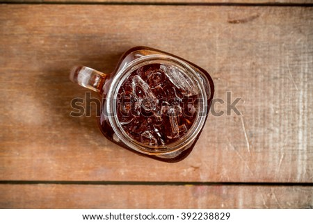 Thai Ice tea in mug on wood background