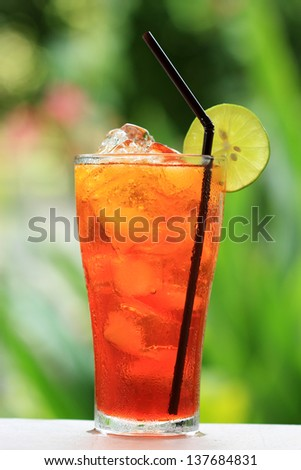 Thai Ice Tea Lemon/Iced drink with slices of lime and ice. - stock photo