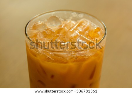 Thai ice tea with milk in glass.