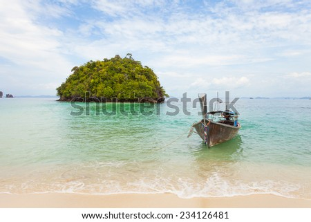 Thai island with traditional long tail boat
