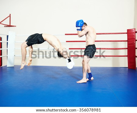 Thai kickboxing. Muay thai fighters at training boxing ring - stock photo