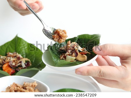 Thai Leaf-Wrapped Bite-Size Appetizer isolated on White - stock photo