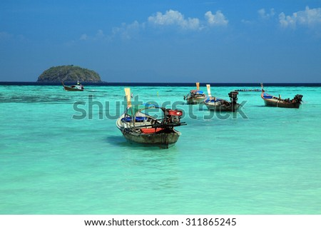 Thai local fishing boats on seaside at Lipe island beach of the Andaman sea, in Satun Province of Thailand. - stock photo