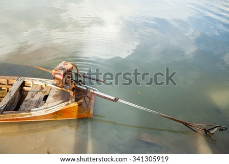 thai long tail fishing boat with motor.