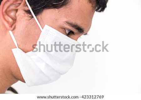 thai man wear face pollution mask on white background - stock photo