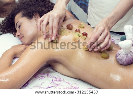 Thai massage bags and grapes in a beauty salon - stock photo