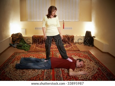 Thai massage is a type of massage in Thai style that involves stretching and deep massage. - stock photo