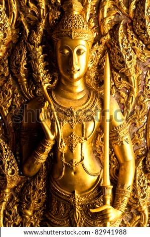 Thai molding art on the wall, U-thaithani province, Thailand. - stock photo