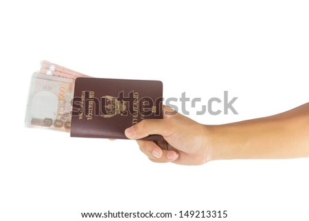 Thai money and passport in man hand isolated on white background