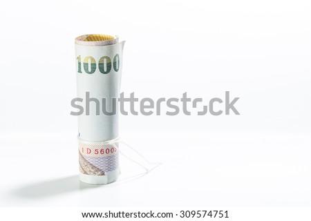 Thai money banknotes on white background. Selective focus point.  - stock photo