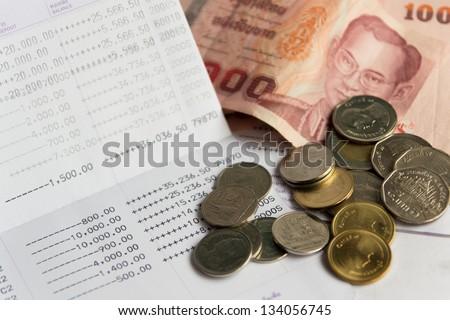 Thai money bath on Saving Account Passbook - stock photo