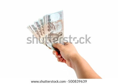 Thai money  in a female hand on white background.