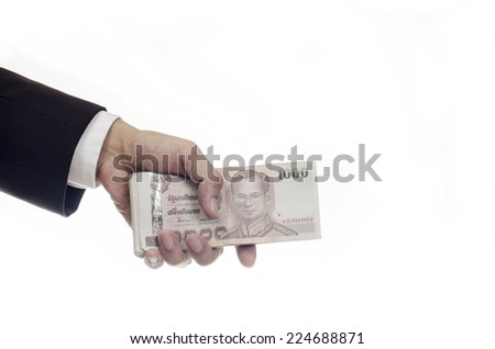 Thai money in hand isolated on white background
