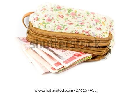 Thai money in woman wallet. - stock photo