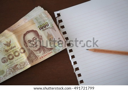 Thai money on wood background