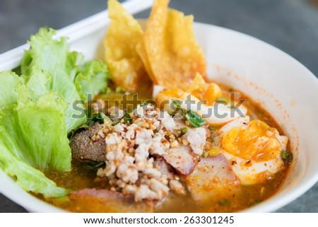 Thai noodle soup in a bowl taste spicy noodle soup. - stock photo