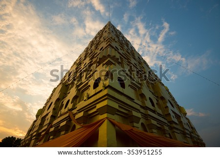 thai pagoda in the morning  In Thailand, any kinds of art decorated in Buddhist church created with money donated by people. They are public domain or treasure of Buddhism, no restrict in copy or use. - stock photo