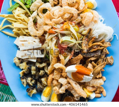 "thai papaya salad hot and spicy mixed from variety of vegetable, peanut , Thai noodle, egg, fish ,pork, pork rind, shellfish and fried meat thai food style.  "" SOM TAM "" - stock photo"