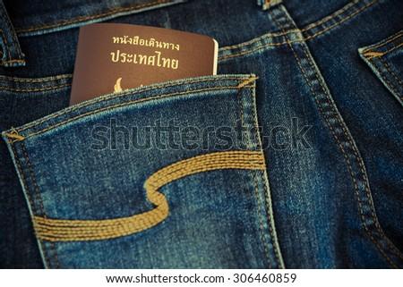 Thai passport in jeans pocket - stock photo