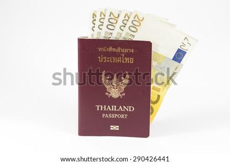 thai passport with euro money - stock photo