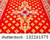 Thai pattern carpet on the ground of church. - stock photo