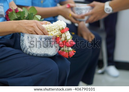 Thai people celebrate Songkran the new year water festival by giving garlands to their seniors and asked for blessings - stock photo