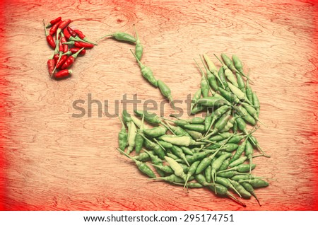 Thai pepper arranged in a heart shape,red and green chilli in two heart shape - stock photo
