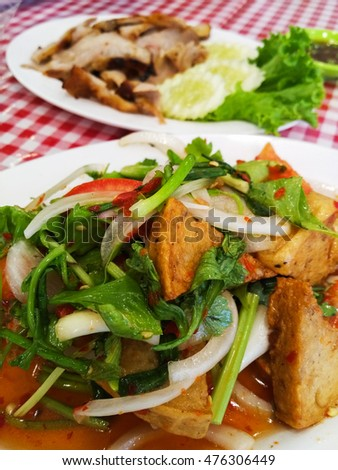 Thai pork sausage salad, Thai cuisine spicy pork salad.