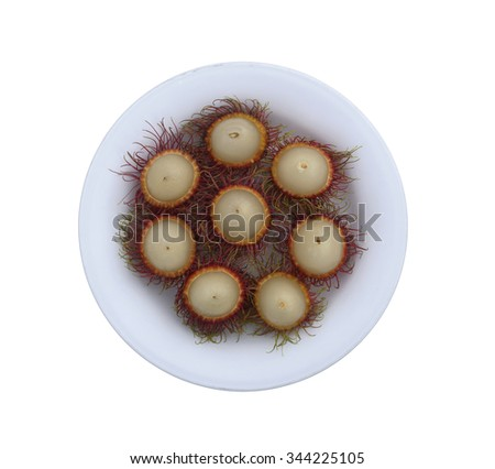 Thai rambutan in white dish on white background - stock photo