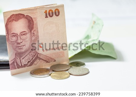 Thai red bank note with coin - stock photo
