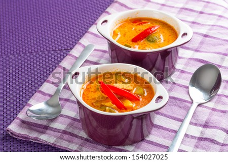 Thai red curry soup with chicken breast - stock photo