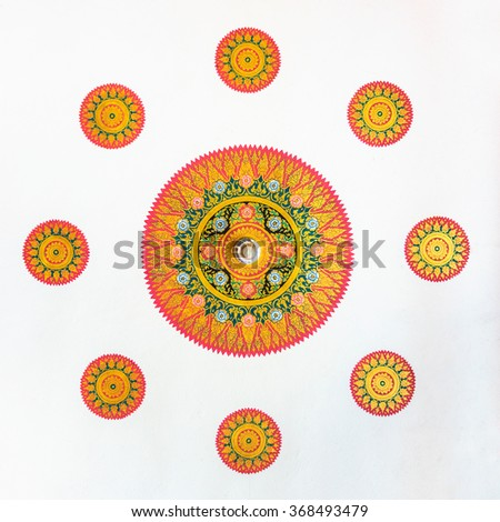 Thai religion art painting on ceiling with hanging light bulb. The painting at Buddhist temple in Thailand, - stock photo