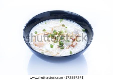 Thai rice porridge with pork - stock photo