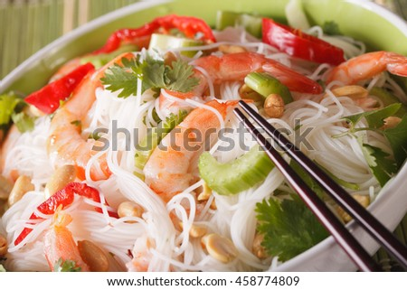 Thai salad with glass noodles, prawns and vegetables macro in a bowl. Horizontal - stock photo