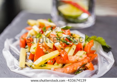 Thai salad with mango and tomato
