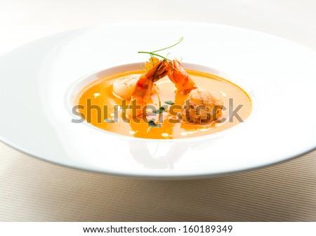 Thai shrimp cream soup with scallops and tiger prawns  - stock photo