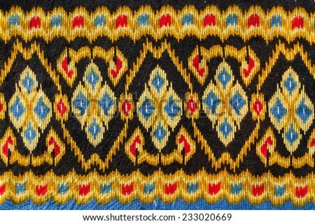 Thai silk fabric close up pattern. - stock photo