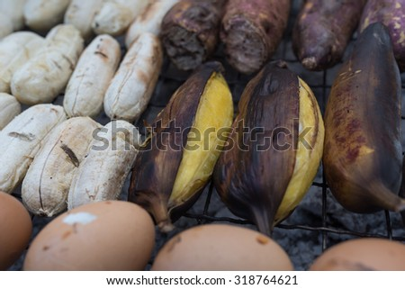 Thai snack grilled banana at street food in thailand - stock photo