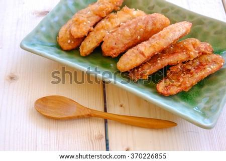 Thai snack sweetened fried banana fritters - stock photo