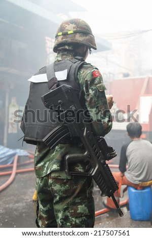 Thai Soldier with gun at the back side