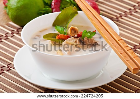 Thai soup with chicken and mushrooms - stock photo