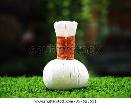 Thai spa massage compress balls, herbal ball and relax, Thailand - stock photo