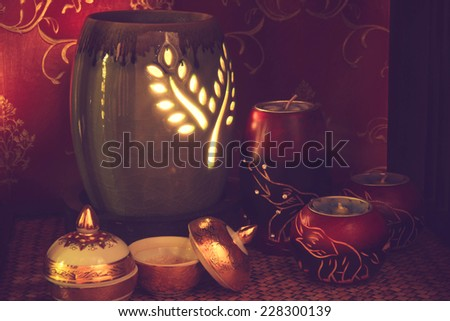 Thai spa massage setting with aroma oil and candles in thai style. - stock photo