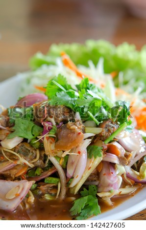 thai spicy cockles salad ,  served with fresh vegetable