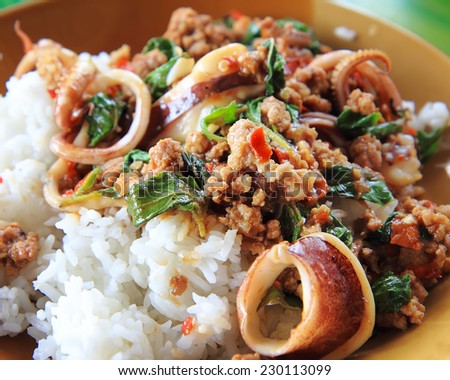 Thai spicy food basil pork fried rice recipe,Krapao Mooh. - stock photo