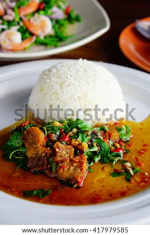Thai spicy food, rice with stir fried pork and basil  - stock photo